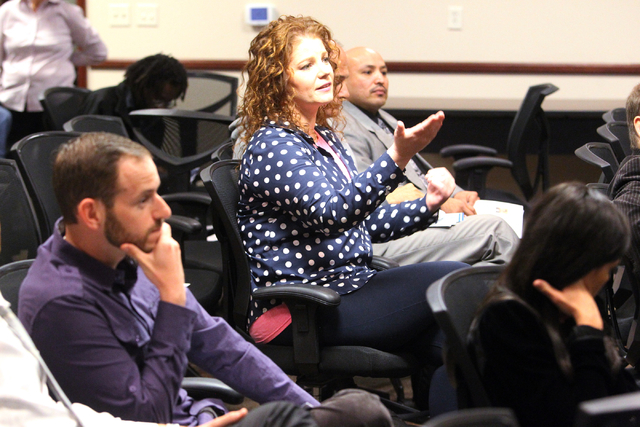 Mona Lisa Samuelson, center, asks a question during a panel discussion about medical marijuanaճ impact on Nevada at United Way of Southern Nevada at 5830 W. Flamingo Road in Las Vegas on Thu ...