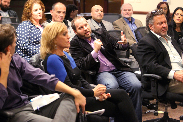 Andrew Rothbart, center, asks a question during a panel discussion about medical marijuanaճ impact on Nevada at United Way of Southern Nevada at 5830 W. Flamingo Road in Las Vegas on Thursda ...