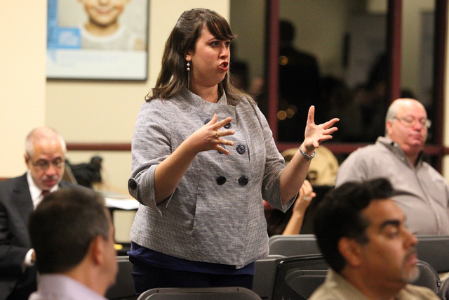 Janna M. Bernstein, residential life coordinator at University of Nevada Las Vegas, asks a question during a panel discussion about medical marijuanaճ impact on Nevada at United Way of South ...
