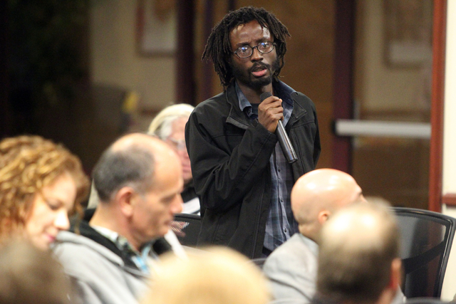 Timothy Eli Addo asks a question during a panel discussion about medical marijuanaճ impact on Nevada at United Way of Southern Nevada at 5830 W. Flamingo Road in Las Vegas on Thursday, Nov.  ...
