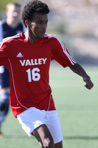 Valley's Abel Tesfa (16) moves the ball down field during the  2014 NIAA Division I Sunrise Region Boys Soccer Finals match, at Heritage Park in Henderson, NV. Saturday, Nov. 8, 2014. (Donavon Loc ...