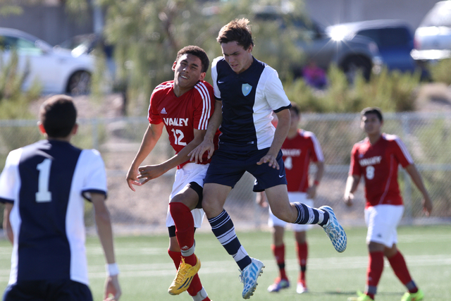 Valley's Damian Alvarez (12) and Foothills'  Mason Reid (2) both jumping for the ball during the  2014 NIAA Division I Sunrise Region Boys Soccer Finals match, at Heritage Park in Henderson, NV. S ...