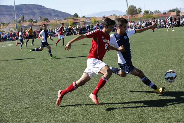 Foothillճ Rony Estrada (6) and Valley's Alejandro Parra (9) both compete for possession of the ball, during the  2014 NIAA Division I Sunrise Region Boys Soccer Finals match, at Heritage Par ...