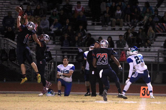 Liberty defensive back Preston Pavlica intercepts a pass intended for Green Valley wide receiver Brayon Williams earlier this season. Pavlica leads the Patriots in tackles and interceptions. (Sam  ...