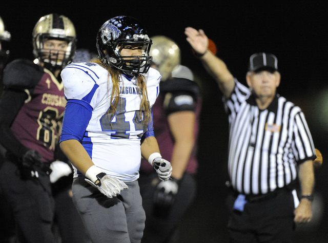 Desert Pines linebacker Vasaifanua Hansell (44) celebrates after Desert Pines recovered a Faith Lutheran fumble in the first half of their Division 1A Southern Region semifinal prep football game  ...