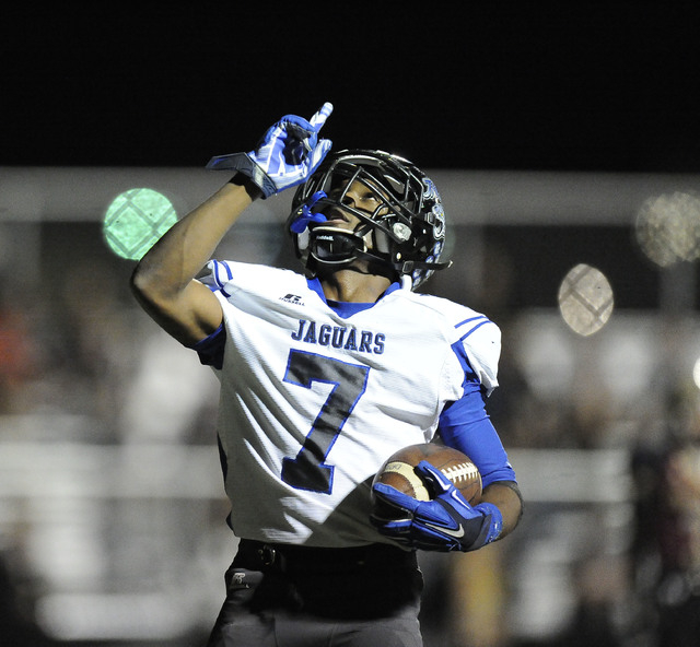 Desert Pines running back Isaiah Morris (7) celebrates his touchdown run against Faith Lutheran in a Division I-A Southern Region semifinal. The sophomore has rushed for 16 TDs to help the Jaguars ...