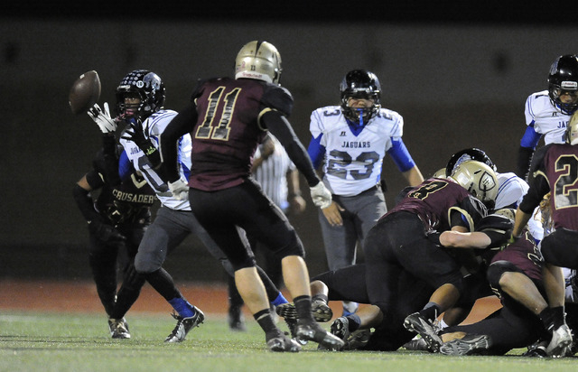 Desert Pines running back Jon McCoy (10) recovers a Desert Pines fumble off a kickoff to score a touchdown against Faith Lutheran in the first half of their Division 1A Southern Region semifinal p ...