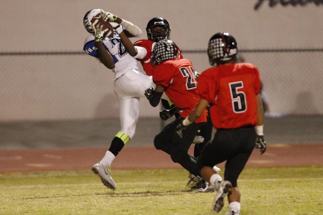Basic's Joshua Villaros (27) makes a touchdown catch against Las Vegas in the Division I Sunrise Regional football semifinal at Las Vegas High on Nov. 14. Villaros has topped 130 yards receiving i ...