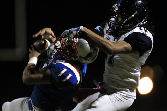 Liberty safety Preston Pavlica intercepts a pass against Canyon Springs on Oct. 2. Pavlica said the Patriots will need to force a couple of turnovers to beat Bishop Gorman on Saturday. (Sam Morris ...