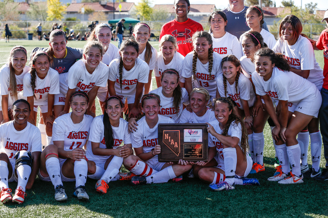Arbor View's Varsity Girls Soccer Team poses with their winning plaque after winning the  2014 NIAA Division I Sunset Region Girls Soccer Finals match, at Heritage Park in Henderson, NV. Saturday, ...