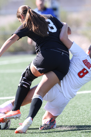 Palo Verdeճ Alexis Lloyd (8) and Valley's Abraham Ortiz (8) both collide while trying to control the ball during the  2014 NIAA Division I Sunset Region Girls Soccer Finals match, at Heritag ...