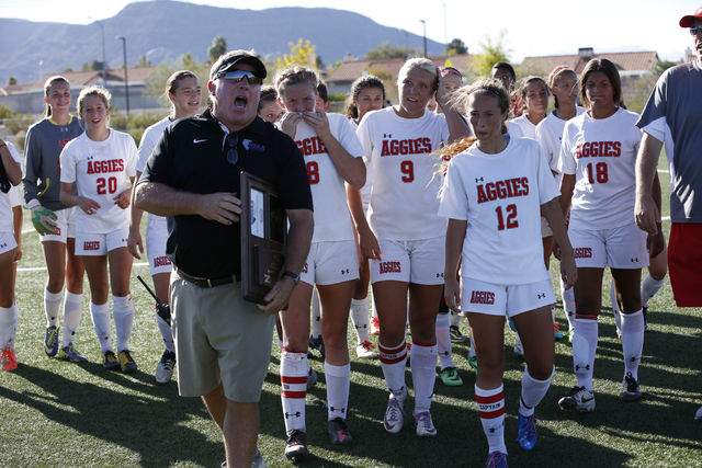Bob Northridge (NIAA Southern Coordinator) prepares to present a plaque to Arbor View's Varsity Girls Soccer team after winning the  2014 NIAA Division I Sunset Region Girls Soccer Finals match, a ...