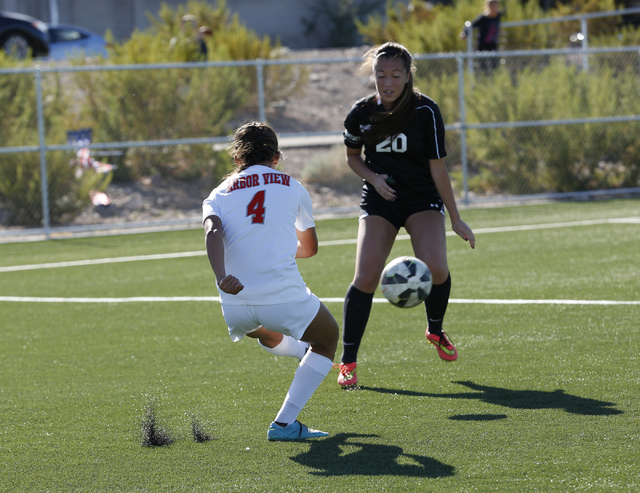 Palo Verdeճ Hannah Coleman (20) moves to block a kick by Arbor View's Katelyn Laurente (4) during the  2014 NIAA Division I Sunset Region Girls Soccer Finals match, at Heritage Park in Hende ...