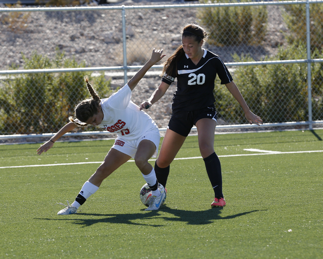 A Display of fancy footwork by Arbor View's Melanie Ara (13) agains Palo Verdeճ Hannah Coleman (20) during the  2014 NIAA Division I Sunset Region Girls Soccer Finals match, at Heritage Park ...