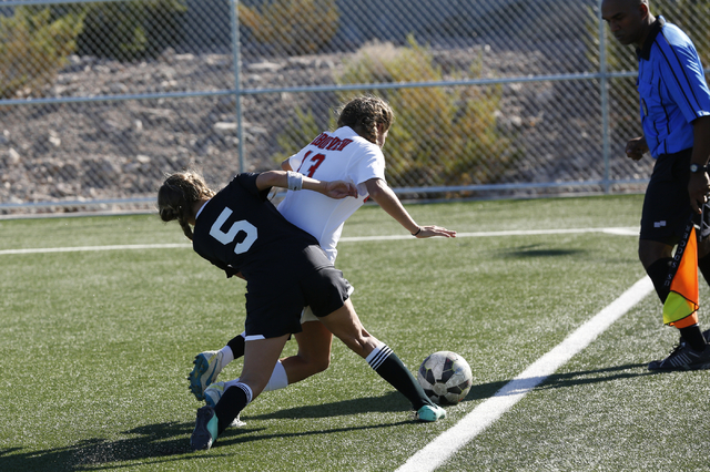 Palo Verdeճ Peyton Feller (5) attempts to take the ball from Arbor View's Melanie Ara (13) by forcing it out of bounds, during the  2014 NIAA Division I Sunset Region Girls Soccer Finals mat ...