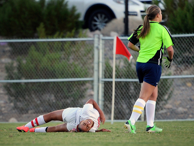 Las Vegas High's Ashlee Jordan lies on the ground after a collision with Foothill goalie Marisa Milne during a Sunrise Region girls soccer quarterfinal game at Heritage Park in Henderson on Tuesda ...
