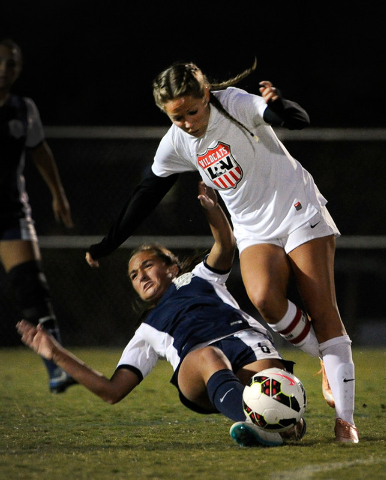 Foothill's Katherine Ballou and Las Vegas's Kara Bowden vie for the ball during a Sunrise Region girls soccer quarterfinal game at Heritage Park in Henderson on Tuesday, Nov. 4, 2014. Foothill won ...