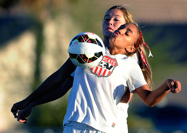 Foothill's Casey Welch, left, and Las Vegas High's Ashlee Jordan vie for the ball during a Sunrise Region girls soccer quarterfinal game at Heritage Park in Henderson on Tuesday, Nov. 4, 2014. Foo ...