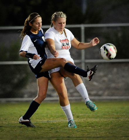 Foorhill's Allison Stubberud, left, reaches around Las Vegas High's Alyson Rhoads for the ball        during a Sunrise Region girls soccer quarterfinal game at Heritage Park in Henderson on Tuesda ...