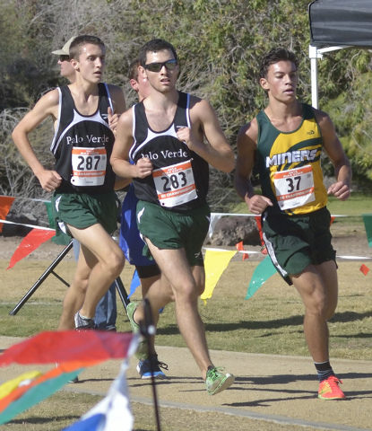 Palo Verde High School runners Noah Landers, left, and Andrew Goldsmith, center, compete with Bishop Manogue Catholic High School's Logan Spodobalski during the Division I boys state cross country ...