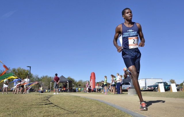 Centennial High School's Dajour Braxton begins the final leg of the Division I boys state cross country championship far ahead of the pack on his way to winning the meet at Sunset Park at Eastern  ...