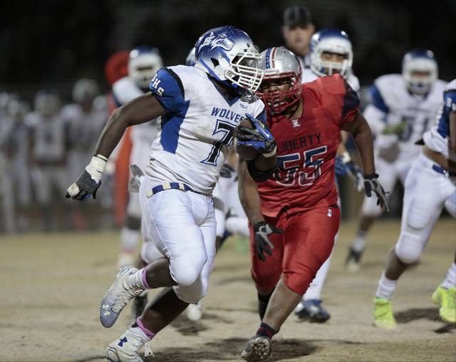 Liberty's Josh Bernard-Lee (55) chases Basic's Kendahl Blakely (7) during the Sunrise Region title game. Bernard-Lee will help lead a defense that faces a major challenge in Bishop Gorman. (Donavo ...