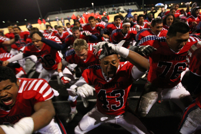 Liberty players celebrate their win over Green Valley in the Division I Sunrise Region championship game at Liberty High School in Henderson on Friday, Nov. 22, 2013. (Chase Stevens/Las Vegas Revi ...
