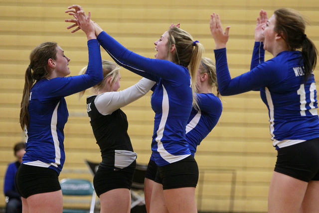 Basic volleyball players celebrate defeating Las Vegas in their Sunrise Region volleyball quarterfinal game Tuesday, Nov. 4, 2014 at Silverado. (Sam Morris/Las Vegas Review-Journal)