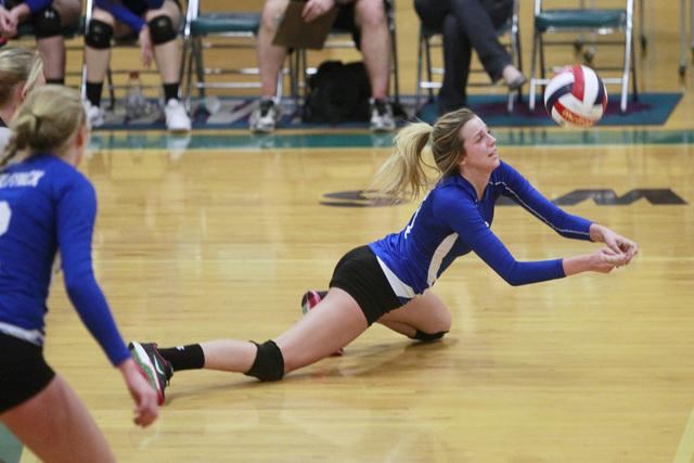 Basic's Kali Wieres digs the ball during their Sunrise Region volleyball quarterfinal game against Las Vegas Tuesday, Nov. 4, 2014 at Silverado. (Sam Morris/Las Vegas Review-Journal)