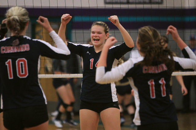 Coronado's Cali Thompson, center, and teammates celebrate winning a point during their Sunrise Region volleyball championship game against Foothill Friday, Nov. 7, 2014 at Silverado High School. C ...