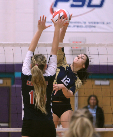 Coronado's Cali Thompson, left, leaps to block a shot by Foothill's Rebecca Hill during their Sunrise Region volleyball championship game Friday, Nov. 7, 2014 at Silverado High School. Coronado wo ...
