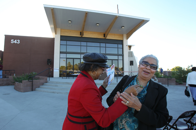 Unity Baptist Church members Juanita Proctor, left, and Pazetta Scott share excitement during a dedication and ribbon-cutting ceremony for their new building at 543 Marion Dr. in Las Vegas Friday, ...
