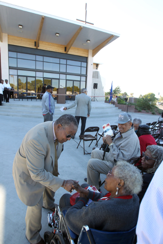 Unity Baptist Church members Franklin Briggs, left, and  Doris Hill greet each other during a dedication and ribbon-cutting ceremony for their new building at 543 Marion Dr. in Las Vegas Friday, O ...