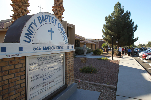 Unity Baptist Church members gather during a dedication and ribbon-cutting ceremony for their new building at 543 Marion Dr. in Las Vegas Friday, Oct. 31, 2014. The new building will allow the chu ...
