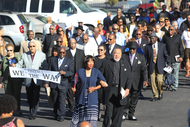 Unity Baptist Church members sing as they march from their old worship building to the new building during a dedication and ribbon-cutting ceremony at 543 Marion Dr. in Las Vegas Friday, Oct. 31,  ...
