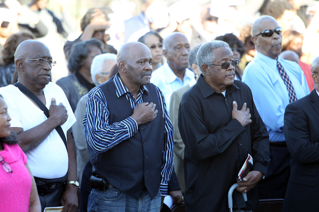 Unity Baptist Church members recite the Pledge of Allegiance during a dedication and ribbon-cutting ceremony for their new building at 543 Marion Dr. in Las Vegas Friday, Oct. 31, 2014. The new bu ...