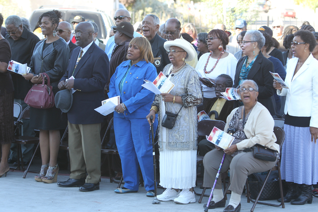 Unity Baptist Church members sing during a dedication and ribbon-cutting ceremony for their new building at 543 Marion Dr. in Las Vegas Friday, Oct. 31, 2014. The new building will allow the churc ...