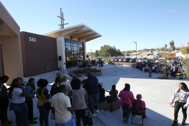 Unity Baptist Church members attend a dedication and ribbon-cutting ceremony for their new building at 543 Marion Dr. in Las Vegas Friday, Oct. 31, 2014. The new building will allow the church to  ...
