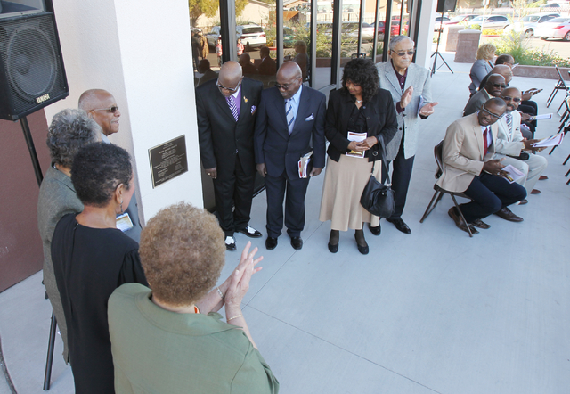 Unity Baptist Church officials unveil a plaque during a dedication and ribbon-cutting ceremony for their new building at 543 Marion Dr. in Las Vegas Friday, Oct. 31, 2014. The new building will al ...