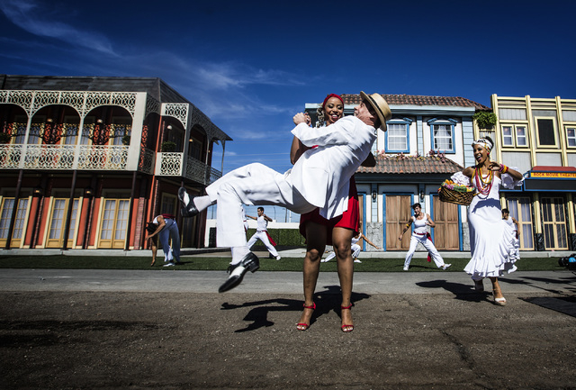 Brazilian performers Vanessa Nascimento holds Carlinhos de Jesus while dancing during the Rock in Rio USA Rock Street sneak-peek event at the site of the former Circus Circus RV Park on Monday, Oc ...