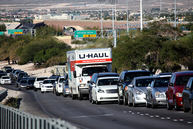 Traffic is backed up after  a sport utility vehicle  rolled over ejecting one passenger who died on the eastbound Summerlin Parkway near Buffalo Drive in Las Vegas on Sunday, November 2, 2014. (Ju ...