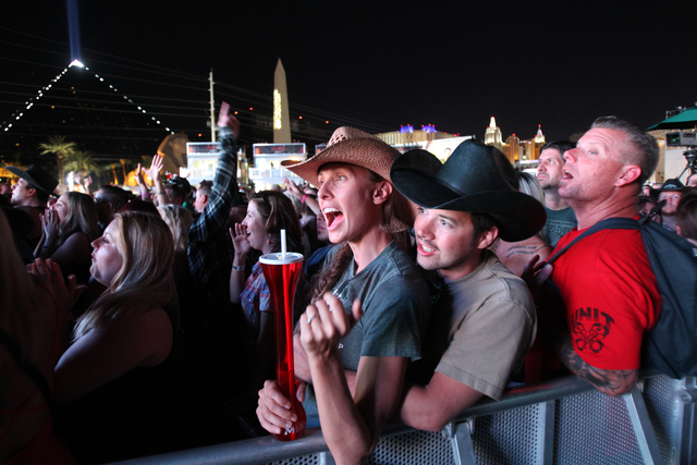 Fans Maki and Bobby Atteberry of Las Vegas cheer as Brantley Gilbert takes the stage during the Route 91 Harvest Festival at the MGM Resorts Village on the Strip on Friday, Oct. 3, 2014. (K.M. Can ...