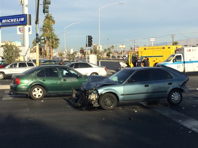 A scooter and several other vehicles were involved in an accident at Sahara Avenue and Fremont Street Thursday morning, Nov. 27, 2014. (Bizuayehu Tesfaye/Las Vegas Review-Journal)
