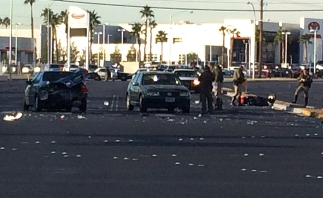 A scooter and several vehicles were involved in an accident at Sahara Avenue and Fremont Street Thursday morning, Nov. 27, 2014. (Bizuayehu Tesfaye/Las Vegas Review-Journal)