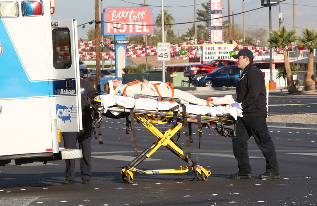 An injured woman is carried on a stretcher from the accident scene into a waiting ambulance Thursday, Nov. 27, 2014. One person was killed and six others were injured in a multi-vehicle crash at S ...