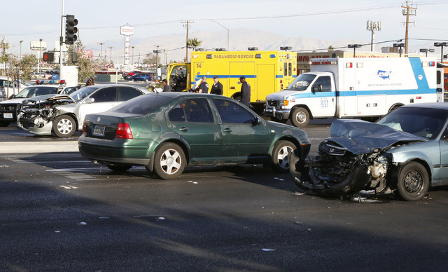 The accident scene where one person was killed and six others were injured in a multi-vehicle crash at Sahara Avenue and Fremont Street Thursday, Nov. 27, 2014. Two people in the scooter were take ...