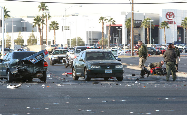 Las Vegas Police investigate the accident where a woman was killed and six other people were injured in a multi-vehicle crash at Sahara Avenue and Fremont Street Thursday, Nov. 27, 2014. Two peopl ...