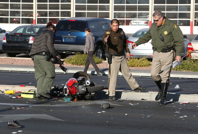 Las Vegas Police investigate the accident scene where a women was killed and six other people were injured in a multi-vehicle crash at Sahara Avenue and Freemont Street Thursday, Nov. 27, 2014. Tw ...