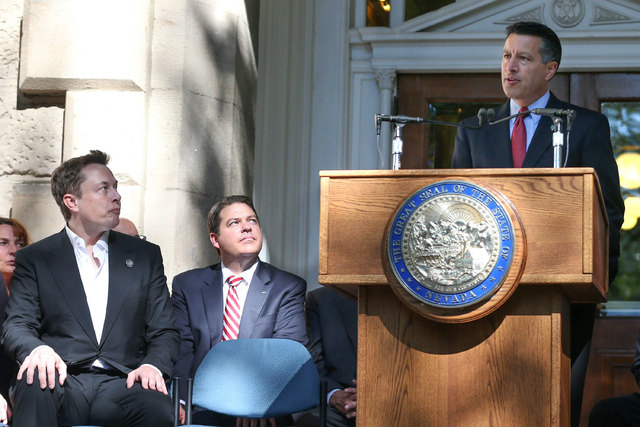 Nevada Gov. Brian Sandoval announces that Nevada was chosen as the new site for the Tesla Motors car battery factory on Sept. 4, 2014, in Carson City. Company CEO Elon Musk is at left. The Governo ...