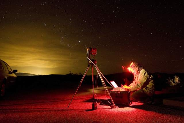 FILE*** JOHN LOCHER/THE ASSOCIATED PRESS Dan Duriscoe works at a special computer controlled camera used to photograph the night sky at Dantes View in Death Valley National Park, Calif. Monday, De ...